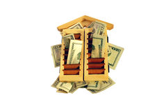 Refinance monies. Refinance monites in the in the form of many large bills tucked into shutters Royalty Free Stock Image