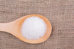 Refine White Sugar II. White refine sugar in wooden spoon on gunny sack background Stock Photo