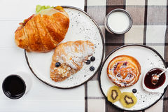 Refined French-style breakfast arranged on a wooden table Royalty Free Stock Images