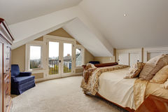 Refined master bedroom with carpet and balcony. Royalty Free Stock Photo