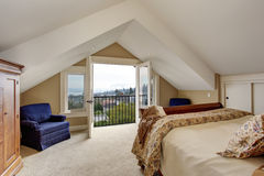 Refined master bedroom with carpet and balcony. Stock Photo