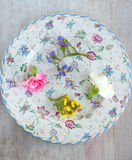 Refined round plate with flowers Stock Photos