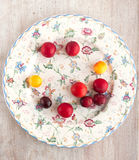 Refined round plate with plums Royalty Free Stock Photo