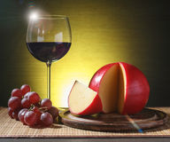 Refined still life of wine, cheese and grapes Stock Photo