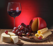 Refined still life of wine, cheese and grapes Stock Photos