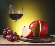 Refined still life of wine, cheese and grapes Stock Image