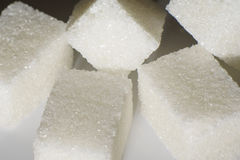 Refined sugar closeup on a white background Royalty Free Stock Photos