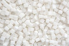 Refined sugar cubes as background. Top view Stock Photos