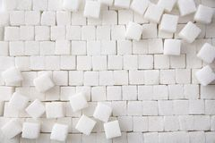 Refined sugar cubes as background. Top view Royalty Free Stock Photos