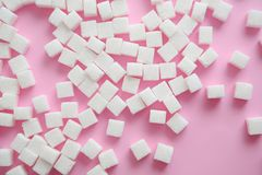 Refined sugar cubes on color background. Top view Royalty Free Stock Photography