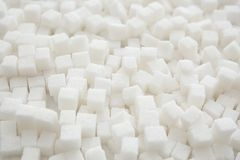 Refined sugar cubes. As background Stock Images