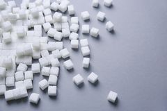 Refined sugar cubes. On grey background Royalty Free Stock Images