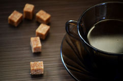 Refined sugar in the form of a question mark and a  coffee Royalty Free Stock Photography