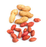Refined and unrefined peanuts in a group. Close up refined and unrefined peanuts together in a group Royalty Free Stock Image