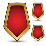 Refined vector three red shield shape emblems. With golden borders. 3d polygonal design element set, clear EPS 8 Royalty Free Stock Photo