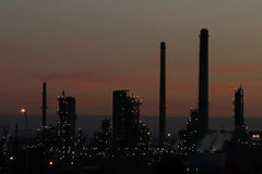Refinery. Oil refinery at sun set Stock Images