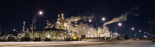 Refinery. Panorama of an oil refinery at night Stock Image