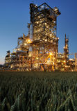 Refinery. At night with a cornfield in the foreground Royalty Free Stock Photography