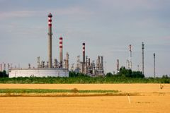 Refinery. Oil refinery plant next to a field Stock Images