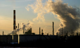 Refinery. An oil refinery in Edmonton,Alberta emits smoke and steam into the air stock images