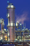 Refinery. Tower and pipes of a chemical installation Royalty Free Stock Photography