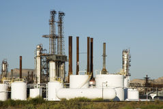 Refinery. A chemical refinery with storage tanks in the foreground Stock Photography