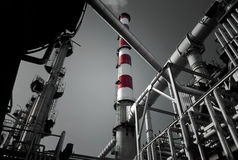 Refinery. Detailed view of a refinery chimney exhausting smoke Stock Image