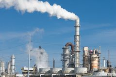 Refinery. Smoke coming from a oil and gas processing refinery Stock Photos