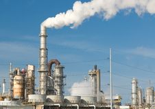 Refinery. Smoke coming from a oil and gas processing refinery Royalty Free Stock Photos