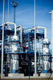 Refinery factory. Petrochemical refinery pipes and tanks in a factory Stock Photography