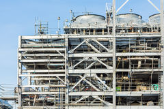 Refinery Factory with LNG - Stock Image. Assembling of liquefied natural gas Refinery Factory with LNG storage tank using for Oil and gas industry background Royalty Free Stock Image