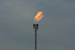 Refinery Flare Smokestack Burning Natural Gas. A refinery fire tower burning off natural gas Royalty Free Stock Photo
