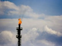 Refinery horn. Oil refinery horn burning excess gas, industrial Stock Photos