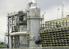 A REFINERY IN HOUSTON/GALVESTON AREA. THIS IS A REFINERY  I SAW WHEN I WAS IN TEXAS AND FOUND VERY INTERESTING.  IT HAS A WEB OF PIPES AND TUBES AND LADDERS AND Royalty Free Stock Photo