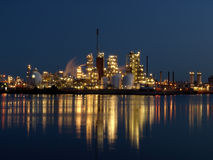 Petrochemical plant at night. A petrochemical plant at night shining lights over the river Merwede in Papendrecht, Netherlands royalty free stock photos