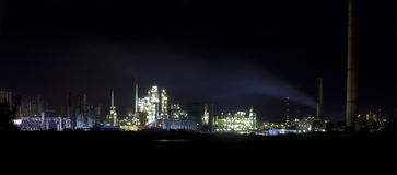 refinery in night away from the city Stock Photo