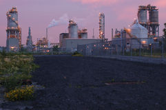 Refinery at night in Montreal (pink version). Refinery before sunrise. Camera: Nikon D50, 50mm lens, F=2.8 Stock Photo