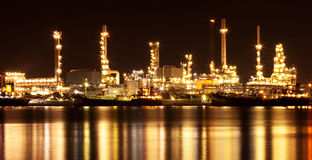 Refinery oil plant at night Stock Images