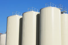 Refinery oil storage tanks and blue sky royalty free stock photos