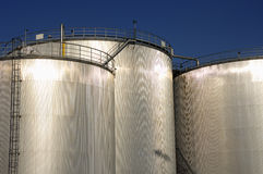 Refinery oil tanks in sunlight Stock Photo