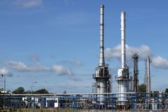 Refinery petrochemical plant chimneys and pipeline industry. Refinery petrochemical plant chimneys and pipeline oil industry royalty free stock image