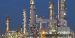 Refinery plant exterior structure against dusky blue sky Stock Photography