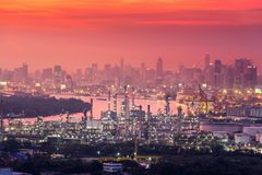 Refinery plant and urban in sunset scene, Bangkok cityscape. Refinery plant and urban in sunset scene., Bangkok cityscape royalty free stock photo
