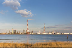 Refinery And River In Evening Sunlight Stock Image
