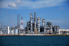 Refinery in Singapore. Large stainless steel towers and pipes Royalty Free Stock Photography