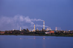 Refinery in storm Royalty Free Stock Images