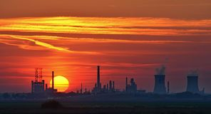 Oil refinery. View of oil petrochemical refinery at sunset royalty free stock photo
