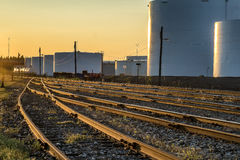 Refinery tank  and  train liquid cars. Oil refinery tanks train liquid cars  in  Montreal at sunset Royalty Free Stock Photos