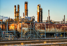 Refinery Tanks and chimney. Oil refinery tanks and chimney in  Montreal at sunset Royalty Free Stock Photos