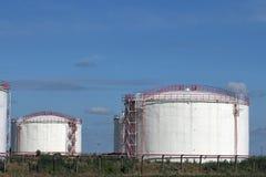 Refinery tanks on field Royalty Free Stock Photos